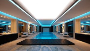 luxury swimming pool with custom backlit stretch ceiling and walls