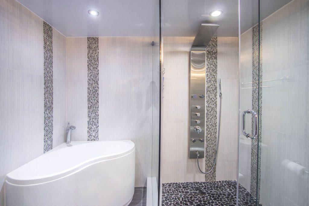 shower and bathtub in luxury bathroom with stretch ceiling technology
