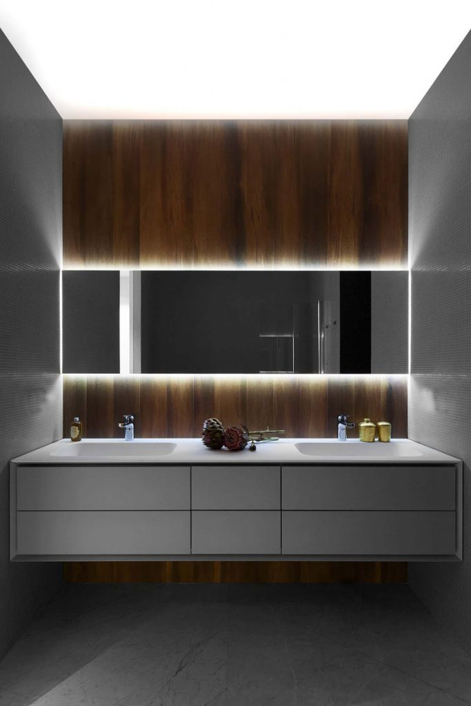 modern bathroom with stretch ceiling led lights and backlit wall mirror