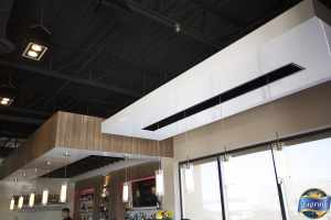 multilevel white reflective stretch ceiling in a restaurant