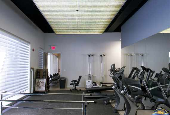 small GYM with matte backlit stretch ceiling