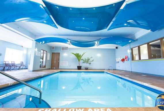 multilevel blue modular structures in amazing swimming pool area