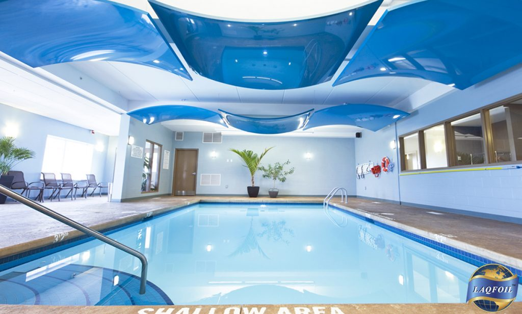 swimming pool with blue 3D Forms of Modular Structures ceiling