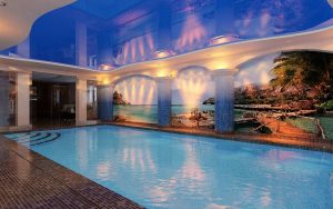 amazing swimming pool with high gloss stretch ceiling and luxury printed wall murals