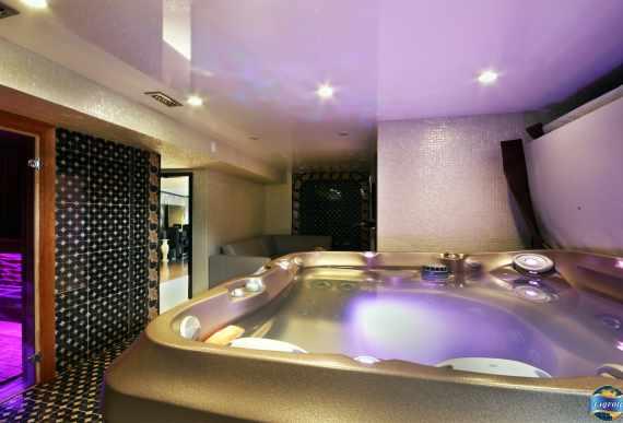 Glossy Stretch Ceiling in Luxury Hot Tub Room