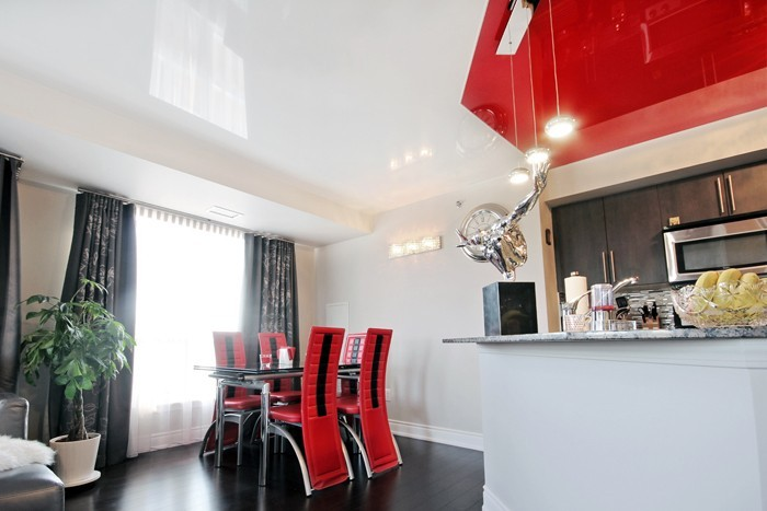 Custom Kitchen with Multilevel White and Red Reflective Stretch Ceiling