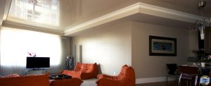 luxury living room with beige high gloss stretch ceiling by laqfoil team Delhi
