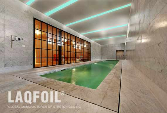 green liner lights ceiling in pool area