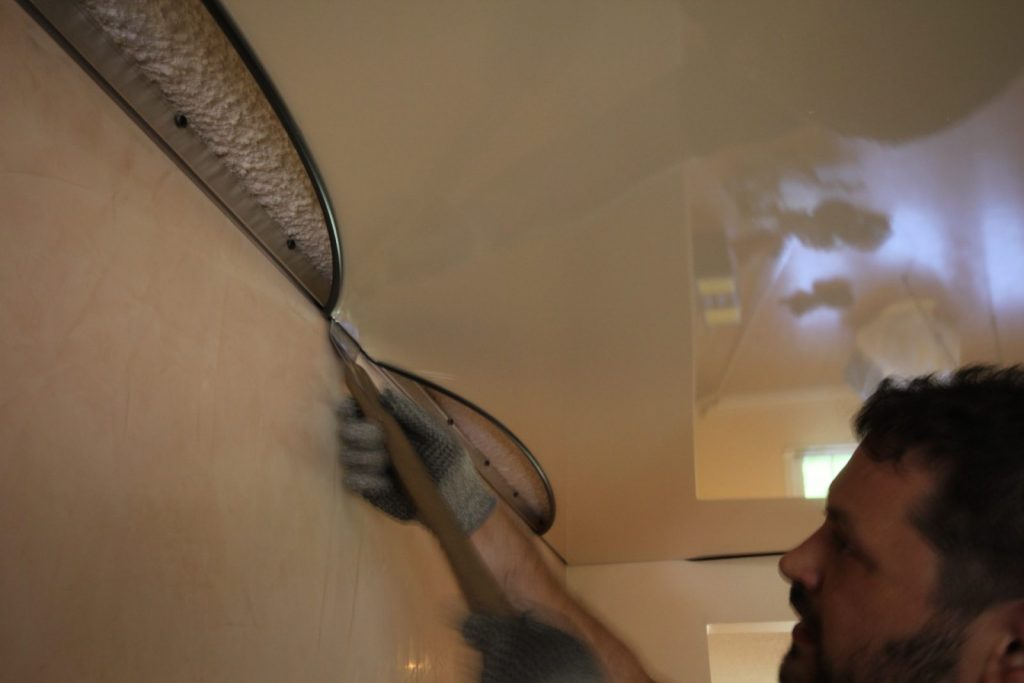 laqfoil team installing stretch fabric on the ceiling