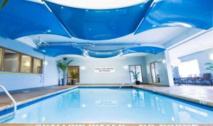 multilevel blue modular structures over amazing swimming pool