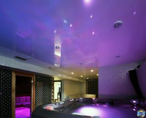 gloss stretch ceiling with build in potlights in hot tub room in the basement