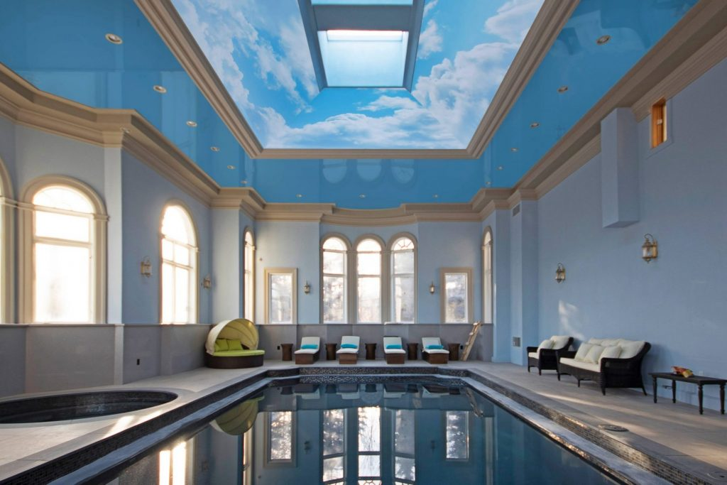 amazing sky printed ceiling in swimming pool by laqfoil