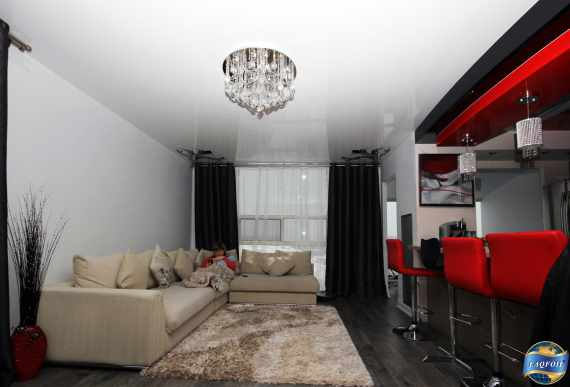white reflective stretch ceiling in condo living room