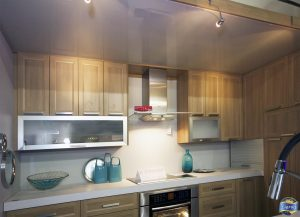 laqfoil project of small kitchen with reflective stretch ceiling Germany