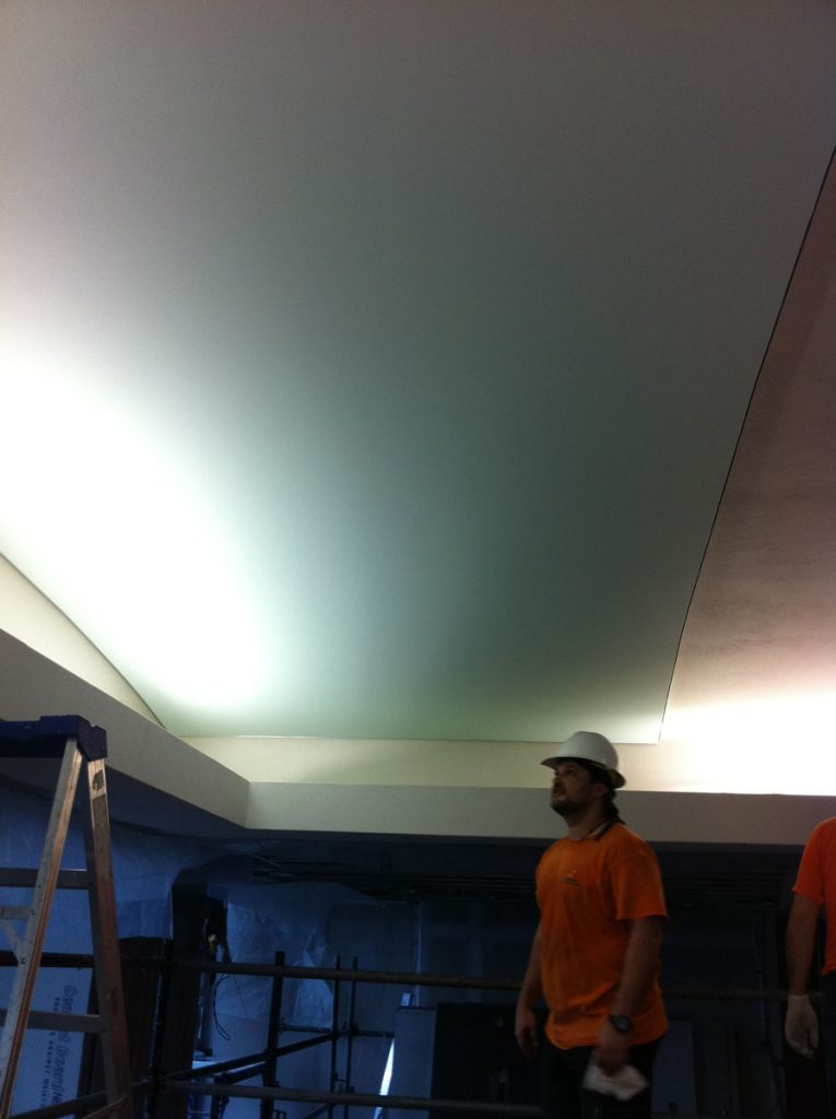 laqfoil team installing stretch ceiling fabric
