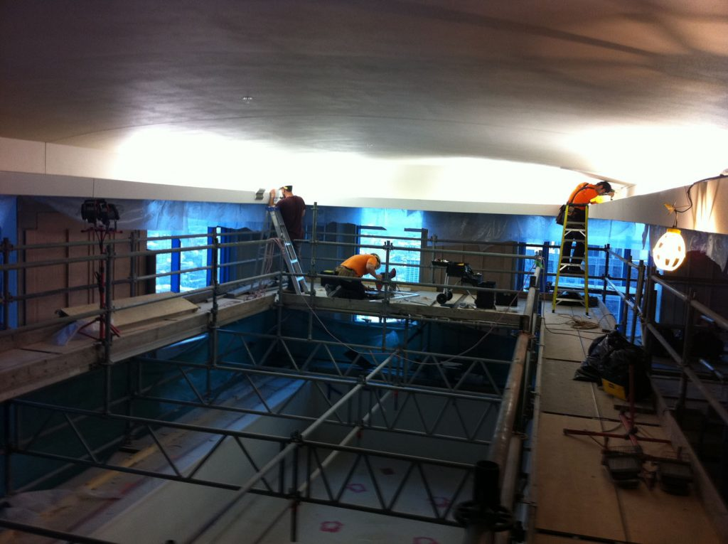 laqfoil team working on installing stretch ceiling in hotel