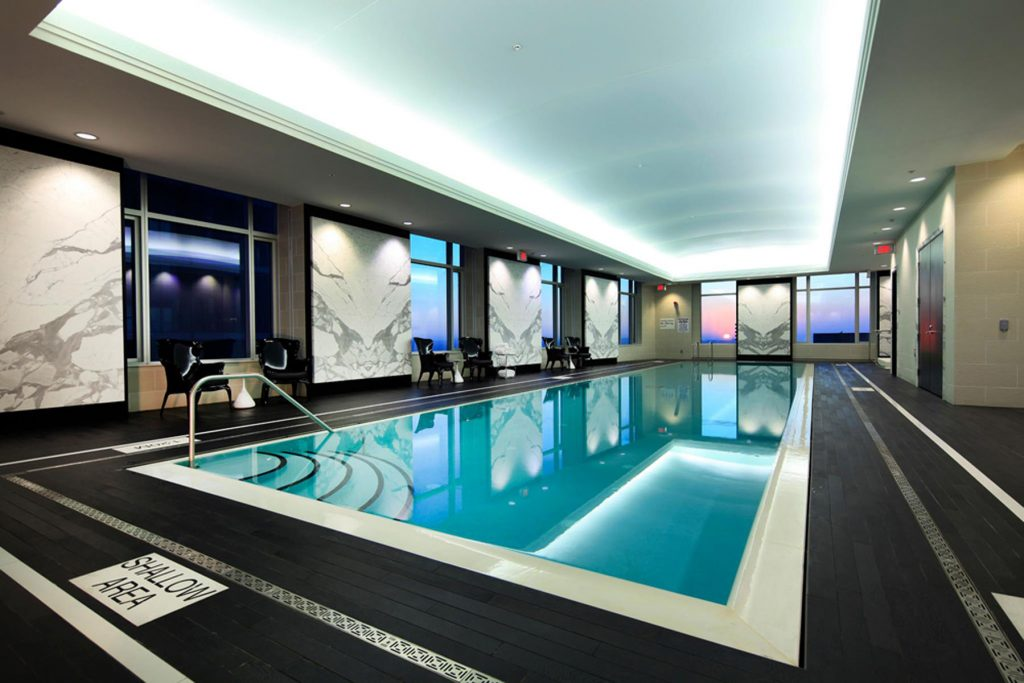 blue back-lit high gloss stretch ceiling in swimming pool area