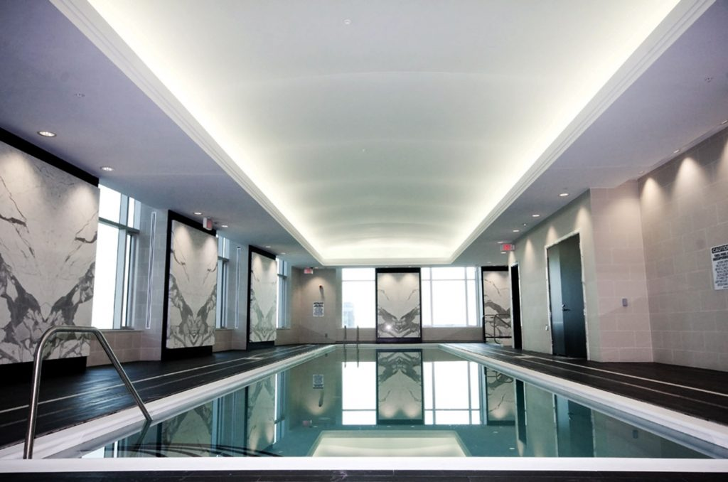 back lit reflective stretch ceiling and custom wall cover pool area
