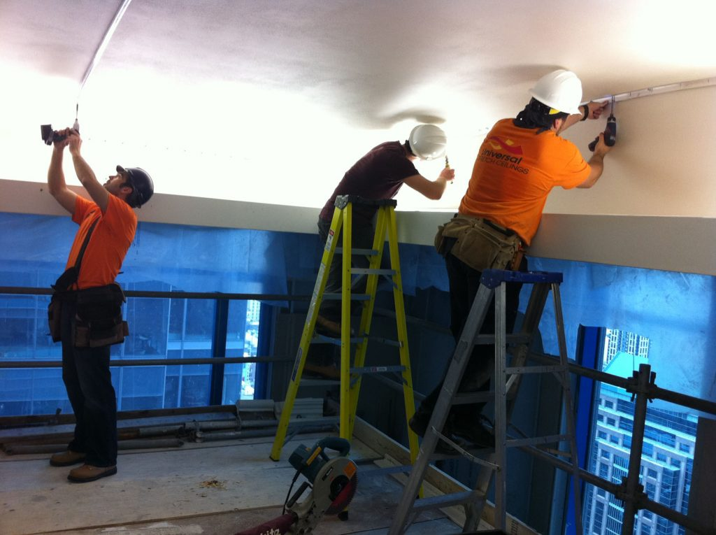 laqfoil team is working on installing stretch fabric in hotel