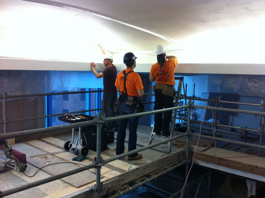 laqfoil team installing stretch ceiling in swimming pool area