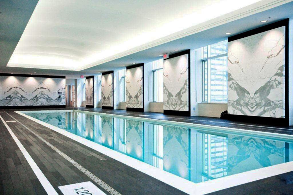swiming pool area with custom wall murals and stretch ceiling glossy