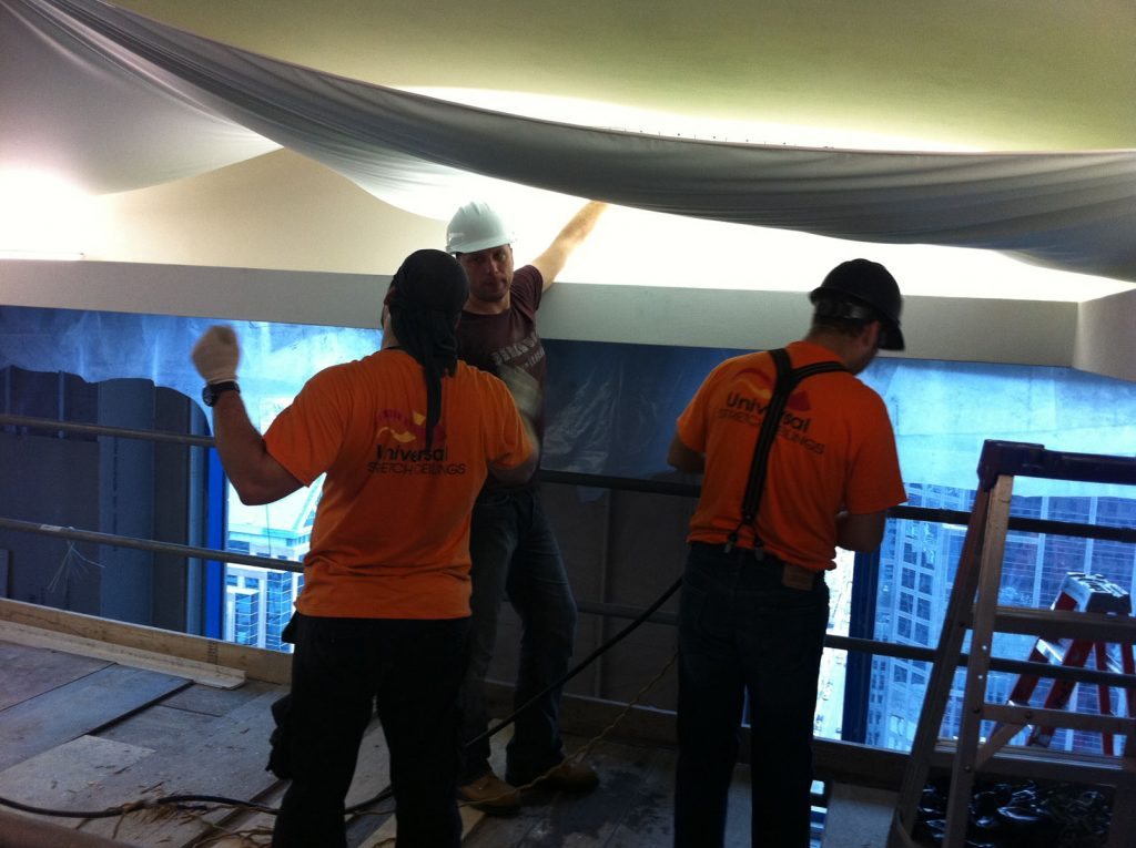 preparing fabric for stretch ceiling in custom hotel