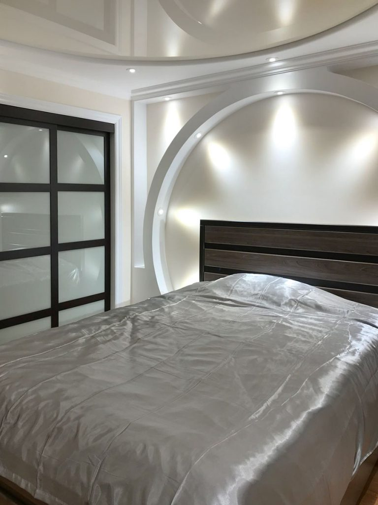 bedroom with back-lit wall and reflective stretch ceiling calgary