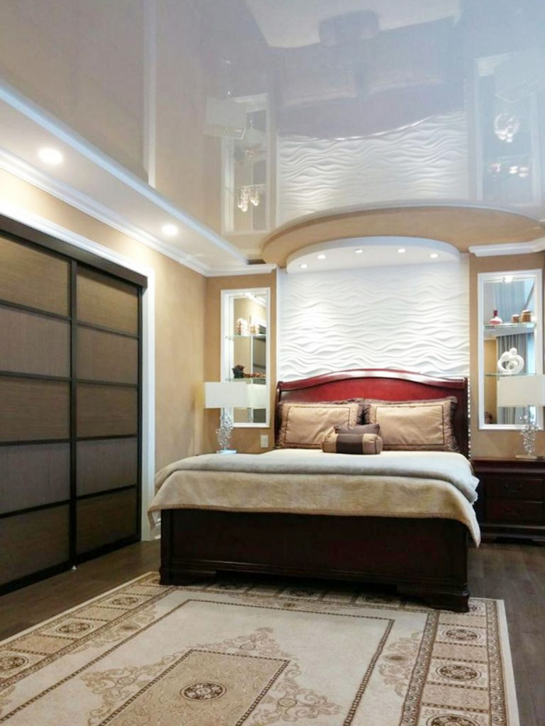 luxury bedroom with ceiling potlights and reflective stretch ceiling fabric