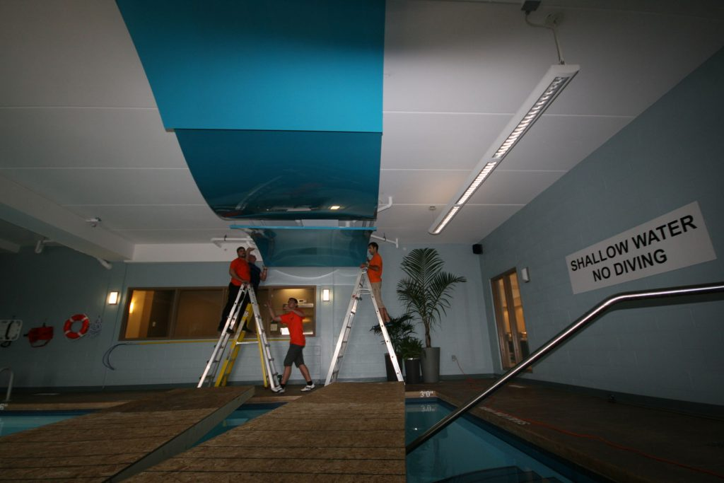 laqfoil team is installing multilevel blue modular structure in pool area