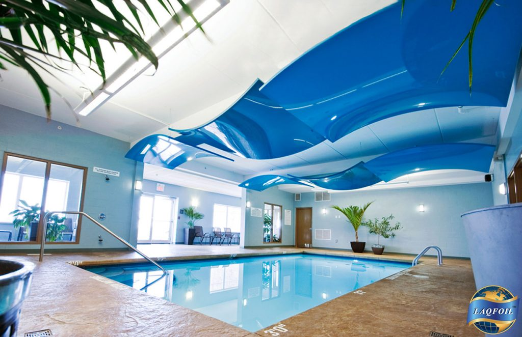 multilevel reflective modular structures in hotel swimming pool