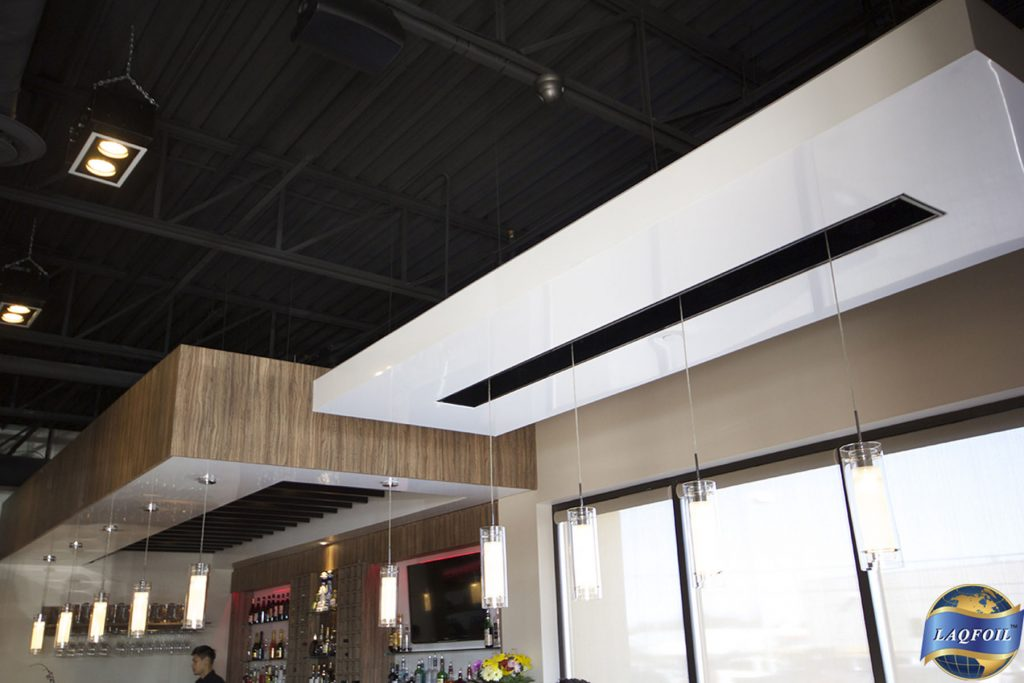 black and white multilevel gloss stretch ceiling in restaurant