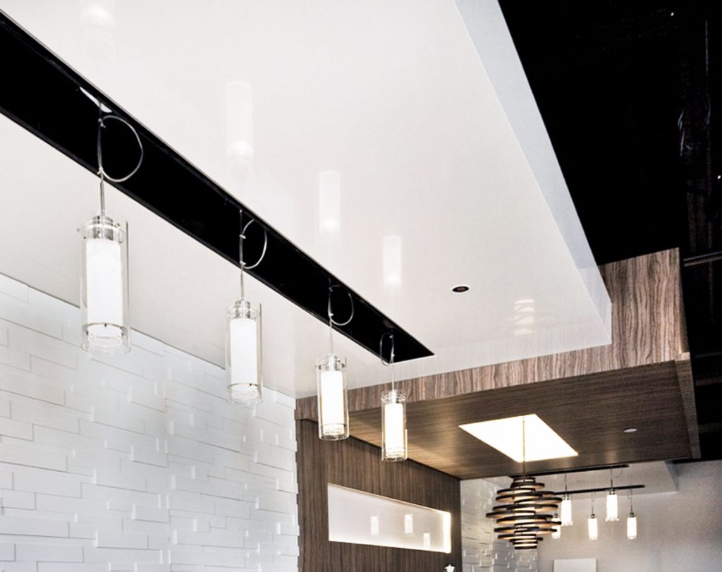 Bucatini Restaurant reflective ceiling and wooden backlit ceiling