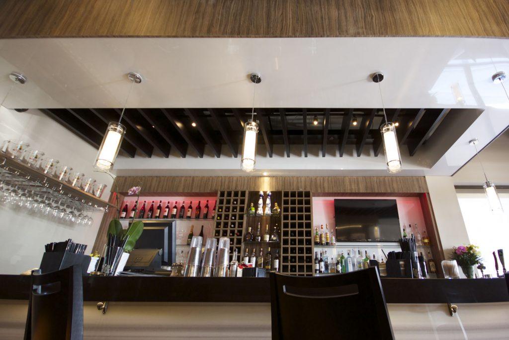 luxury bar with stretch ceiling mirror effect