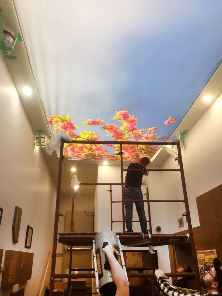 laqfoil team installing stretch ceiling prints