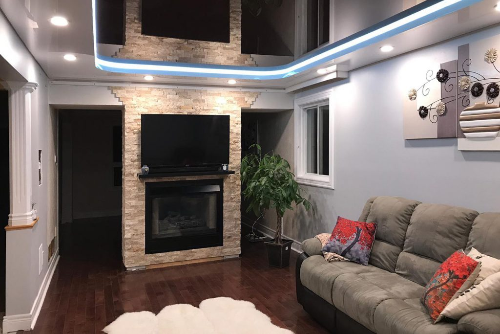 Linear Lights black glossy stretch ceiling in basement living room