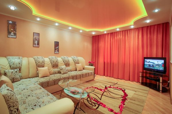 Family Rooms orange multilevel back lit ceiling