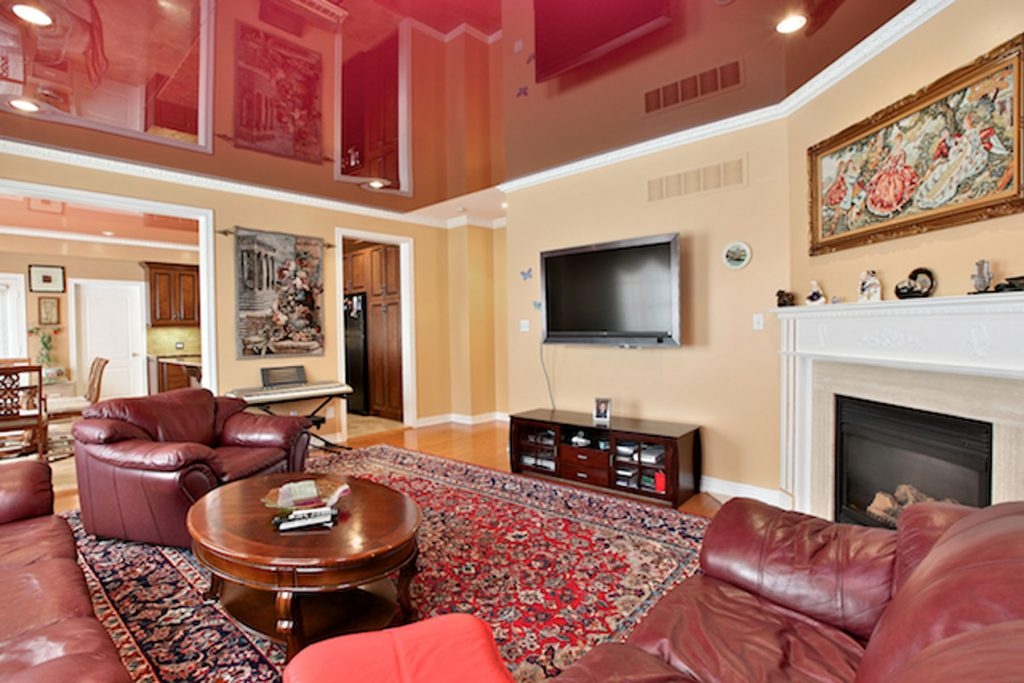 custom living room with red stretch ceiling mirror effect