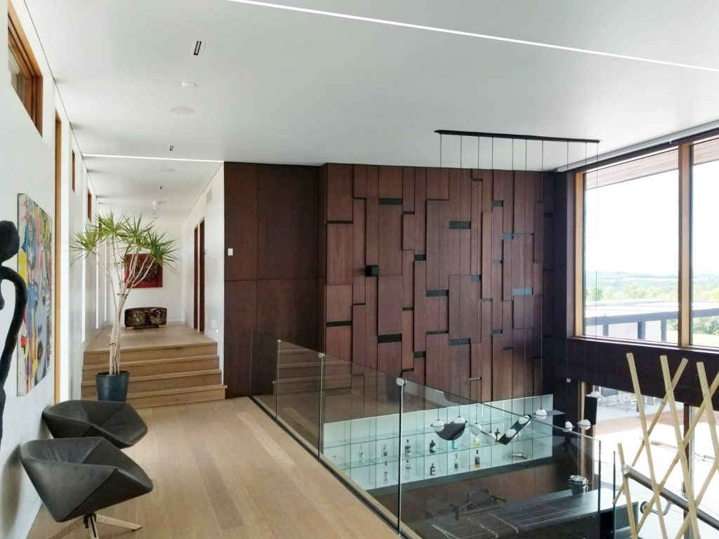 custom home with Linear Lights Ceilings in the second floor by laqfoil