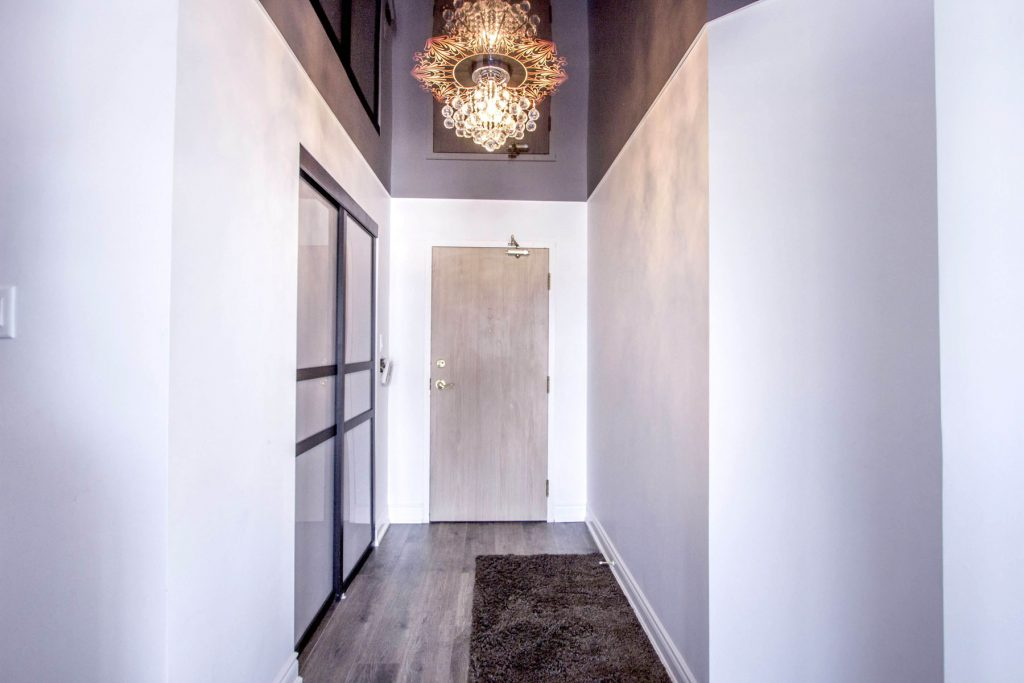 black reflective stretch ceiling in hallway