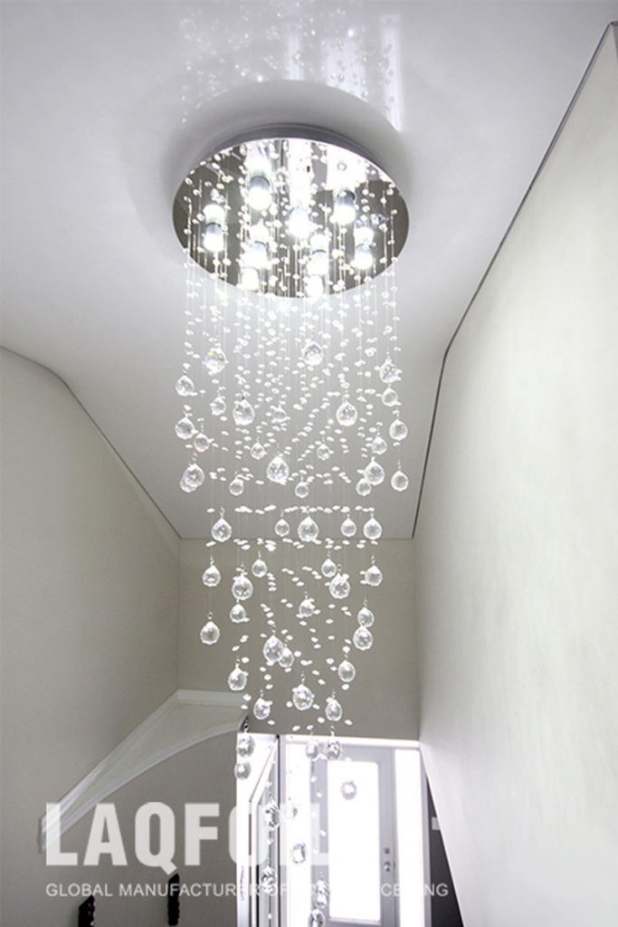 Foyers & Hallways reflective ceiling and custom chandelier