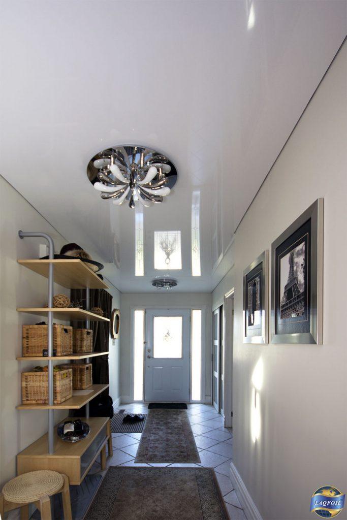 stretch ceiling mirror effect in custom home foyer