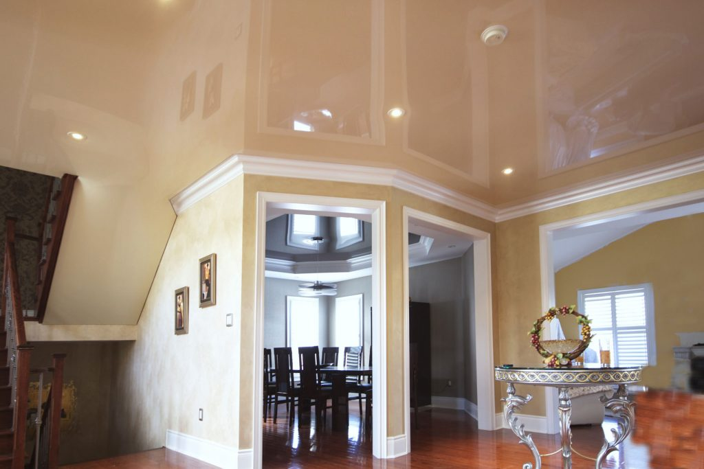 luxury living room with gloss stretch ceiling by laqfoil