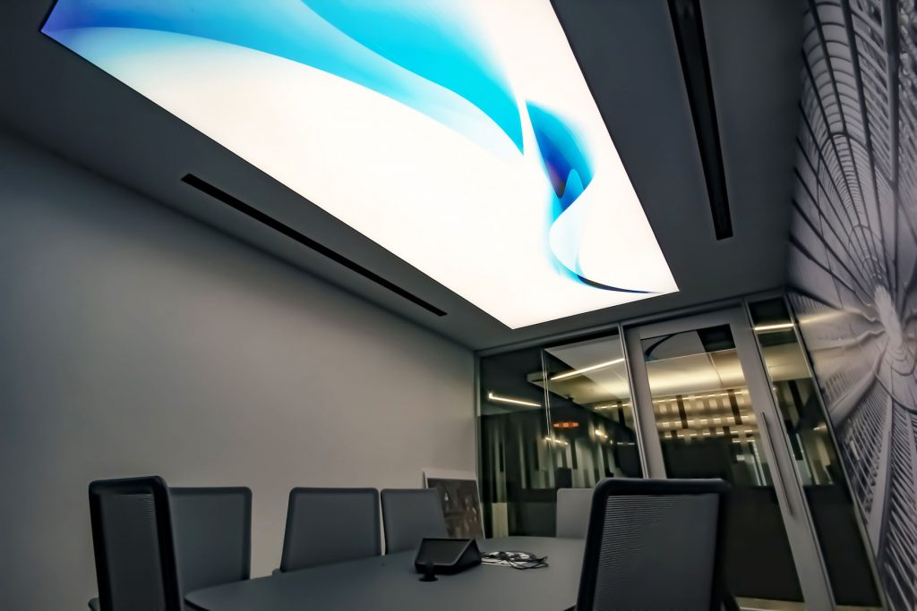 amazing office with back lit printed ceiling