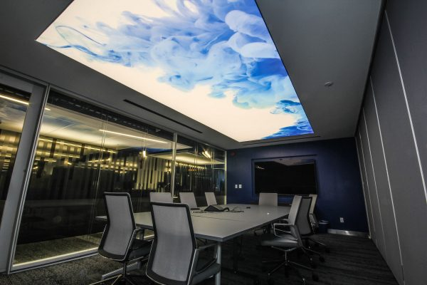 meting room with custom white and blue smoke stretch ceiling backlit  designs canada