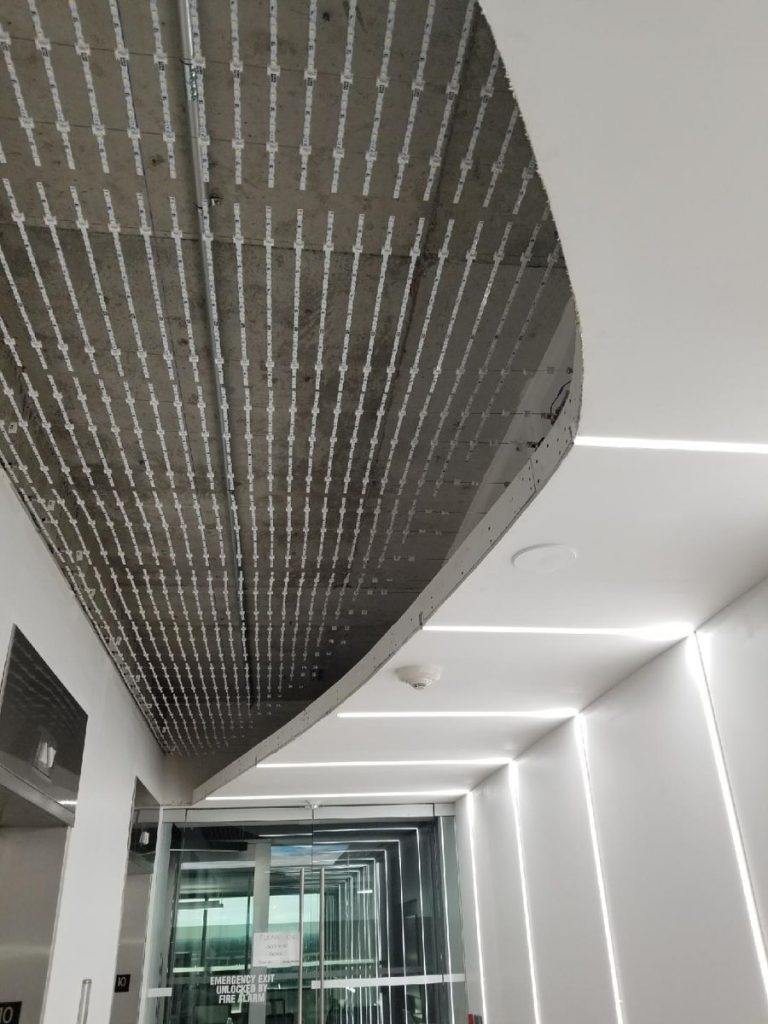 office hallway with Linear Lights Ceilings and walls