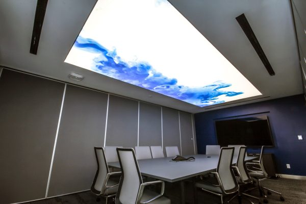 blue and white backlit stretch ceiling in modern office by laqfoil