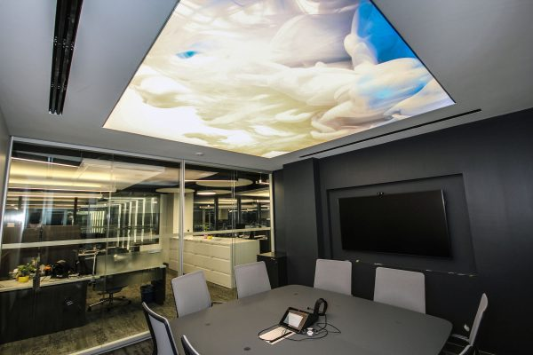 modern office with backlit stretch ceiling