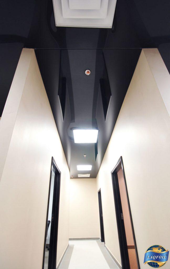 luxury office hallway with custom reflective stretch ceiling
