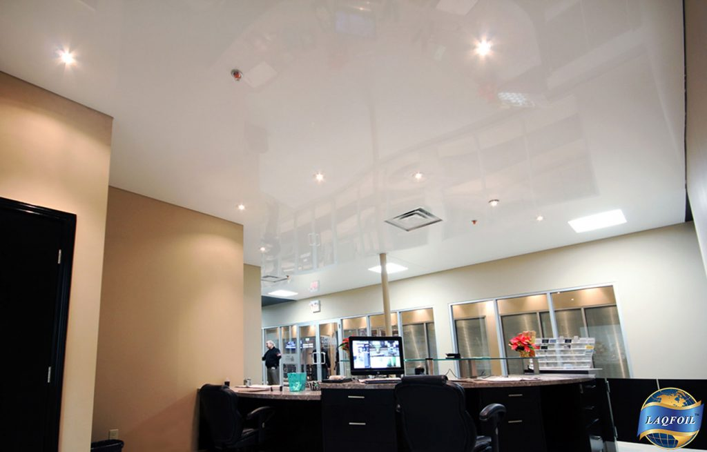 reception area with white reflective ceiling design