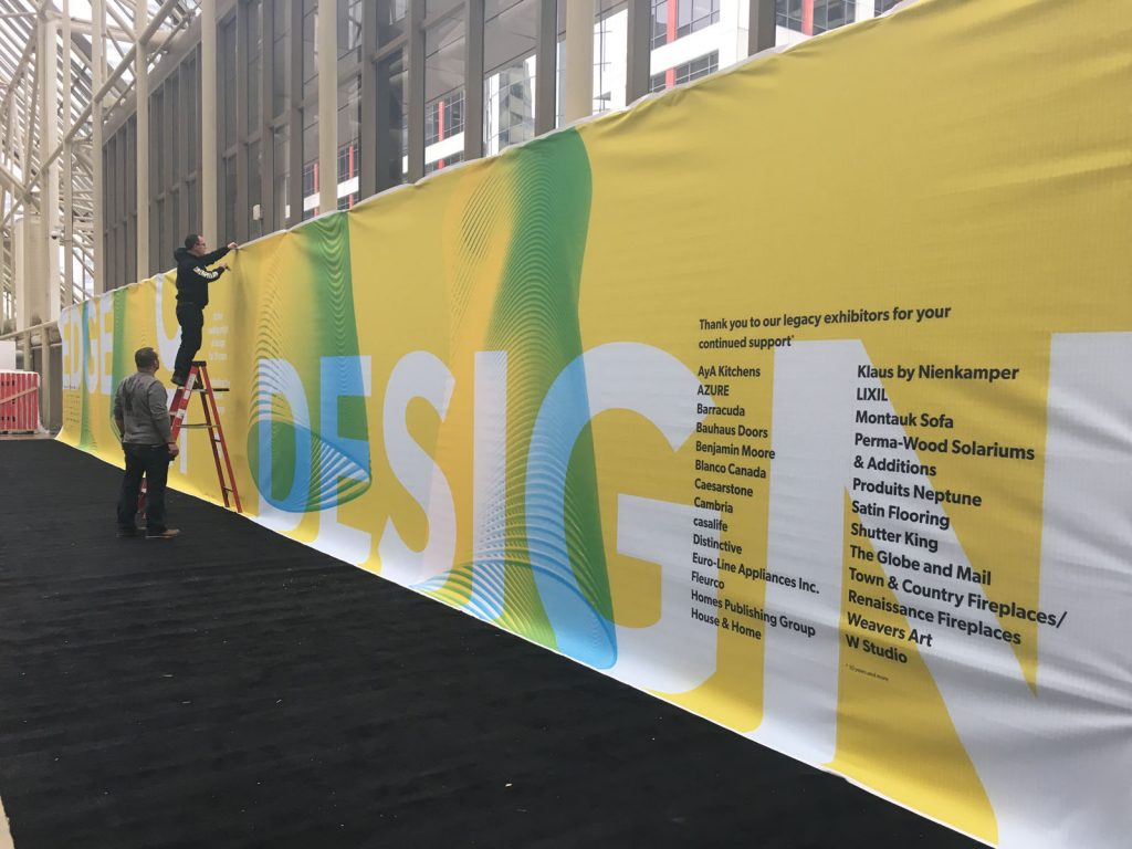 laqfoil team installing custom banner for IDS Sponsorship 2018